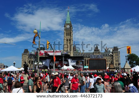 OTTAWA, CANADA - JULY 1, 2016:  People gather on Parliament Hill for the annual Canada Day celebrations which include live music, speeches by dignitaries and fireworks. - stock photo