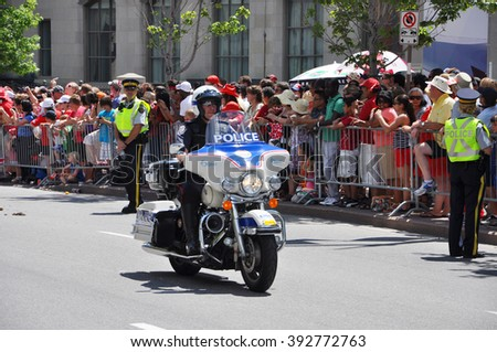 OTTAWA, CANADA - JULY 1: RCMP police tasks on motorcycle guard on Canada Day on July 1, 2011 in Ottawa, Ontario, Canada. - stock photo