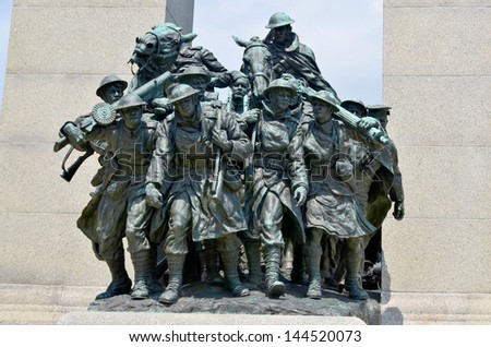 OTTAWA, CANADA - JUNE 30: The National  War Memorial , is a tall granite cenotaph with acreted bronze sculptures, that stands in Confederation Square, June 30, 2013 in Ottawa, Ontario. - stock photo