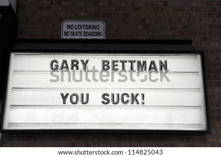 OTTAWA, CANADA - OCT 6:  A sign at PJ Quigleys bar in Ottawa expresses the frustration NHL fans feel with Commissioner Gary Bettman over the NHL lockout Oct 6, 2012 in Ottawa, Ontario, Canada. - stock photo