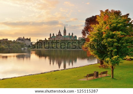 Ottawa city skyline at sunrise in the morning park view over river - stock photo