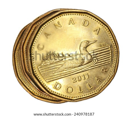 OTTAWA - DECEMBER 2012:  The Canadian one dollar coin, known as the loonie, has replaced the paper dollar bill, and marked its 25th anniversary in 2012, seen in Ottawa December 2012.  - stock photo