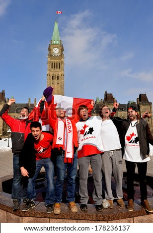 OTTAWA - FEB 23:  Happy Canadian fans sing national anthem to celebrate Canada's defense of Olympic hockey gold with 3-0 win over Sweden on Parliament Hill 10:06 am Feb 23, 2014 in Ottawa, Canada - stock photo