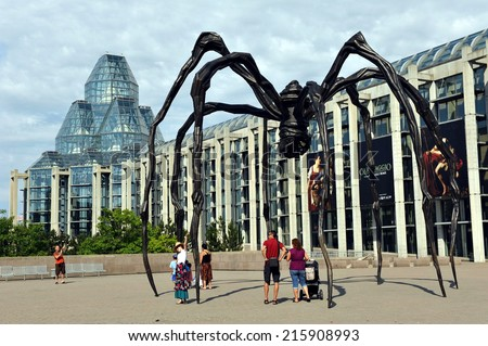 OTTAWA - JULY 2, 2011:  The National Gallery of Canada, a popular tourist attraction designed by Moshe Safdie that opened in 1988. The spider sculpture is the famous Maman by Louise Bourgeois.  - stock photo