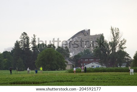 OTTAWA - JULY 13: The Sir John Carling building is demolished by controlled explosives in Ottawa on July 3, 2014. - stock photo