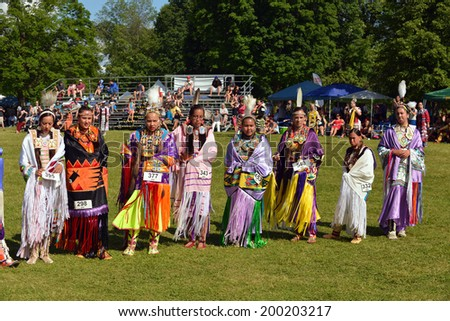 OTTAWA - JUN 22: Native women stand before judges after performing traditional dance at Summer Solstice Aboriginal Arts Festival for Aboriginal Day in Massey Park June 22, 2014 in Ottawa, Canada  - stock photo