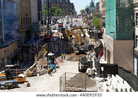 OTTAWA, JUN 17, 2016: Repairs underway on Rideau St to fix the massive sinkhole that opened up during light rail construction and forced the closure of the very busy transit and shopping street.  - stock photo
