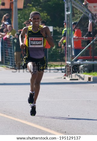 OTTAWA - MAY 25: Ethiopian runner Yemane Tsegay wins men's division of the Ottawa Marathon with a record time, on May 25, 2014 in Ottawa. - stock photo