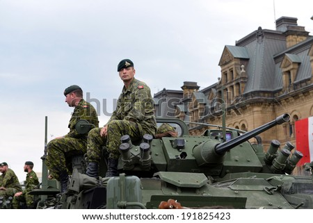 OTTAWA - MAY 9:  Soldiers who served in the Canadian Forces in Afghanistan are honored on Parliament Hill during national Day of Honour May 9, 2014 in Ottawa, Canada - stock photo