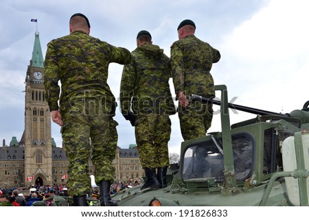 OTTAWA - MAY 9:  Soldiers who served in the Canadian Forces in Afghanistan give salutes while being honored on Parliament Hill during national Day of Honour May 9, 2014 in Ottawa, Canada - stock photo