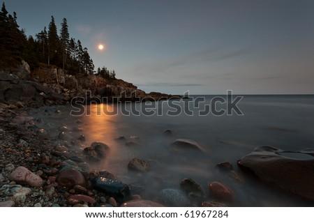Otter Cliff area under moon light, long exposure.  Acadia National Park - stock photo