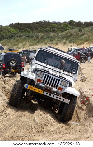 OUDDORP,NETHERLANDS ??12/06/2016;This 4 x 4 beach event takes place in Ouddorp. A large beach with a track made by bulldozers and jeeps so everyone can drive there 4x4 through this sandy hill course   - stock photo