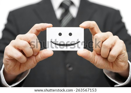 our clients are happy clients, smile on business card - stock photo