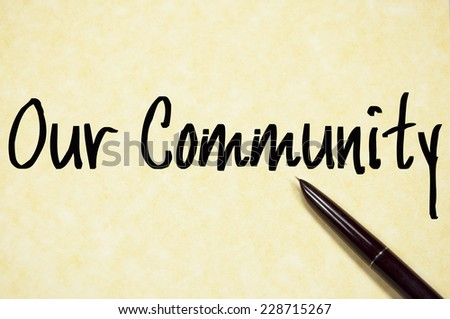 our community text write on paper  - stock photo