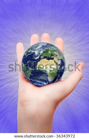our eath in womens hand - stock photo