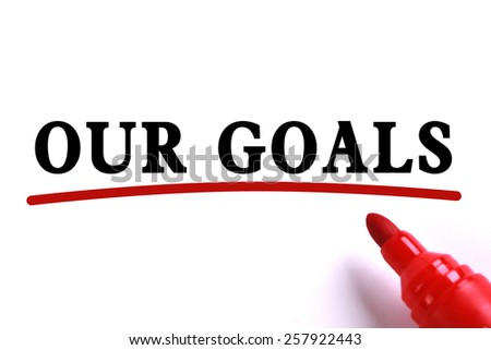 Our Goals Concept text is on white paper with red underline which is written by the red marker. - stock photo