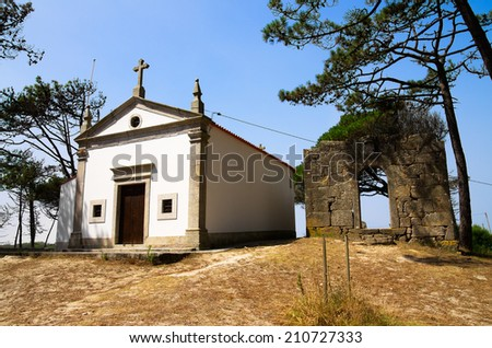 Our Lady of Bonanca chapel and Facho (old lighthouse) da Bonanca ruins on the top of a dune at Ofir. Esposende, Portugal. - stock photo