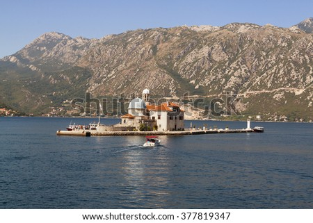 Our Lady of the Rock island and Church in Perast on shore of Boka Kotor bay.  Montenegro, Europe.  - stock photo