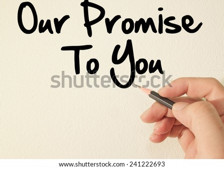 our promise to you text concept write on wall  - stock photo