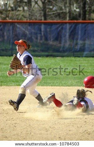 Out at second base, women's softball - stock photo