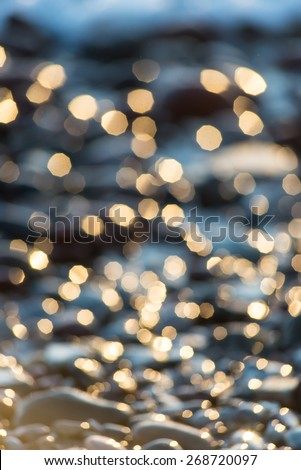out of focus blur background with sea water in sunset light - stock photo