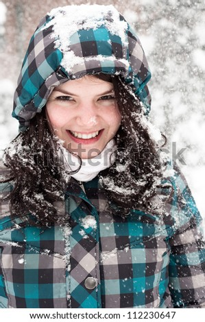 Out of focus picture of a woman with a lot of snowflakes - stock photo