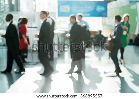 Out of focus shot of business people waiting in line - stock photo