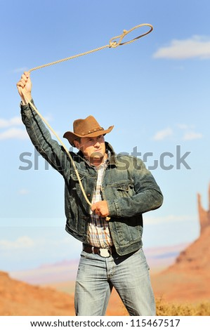 OUT WEST - A cowboy takes time to rest and reflect. - stock photo