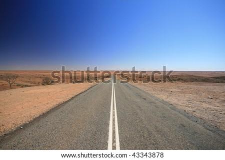 Outback Australia Road, Vanishing into the Desert - stock photo