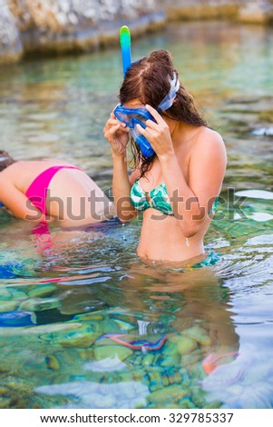Outdoor activity of young people in the salty waters of the sea: snorkeling. - stock photo