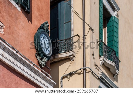 Outdoor analog wall street clock in Venice, Italy - stock photo