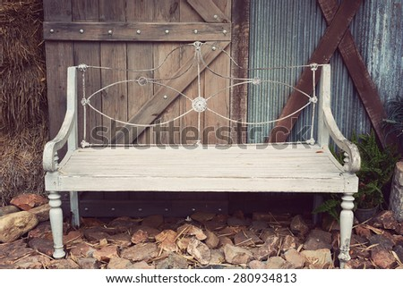 Outdoor antique wood chair - Vintage filter - stock photo