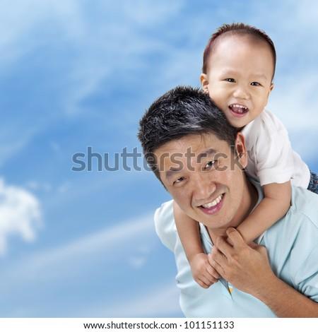 Outdoor Asian family over blue sky - stock photo