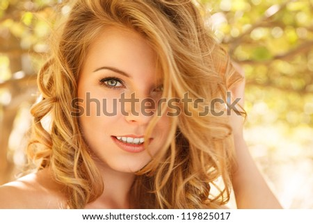 Outdoor autumn portrait of beautiful happy young woman - stock photo