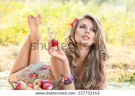Outdoor autumn portrait of beautiful young woman - stock photo