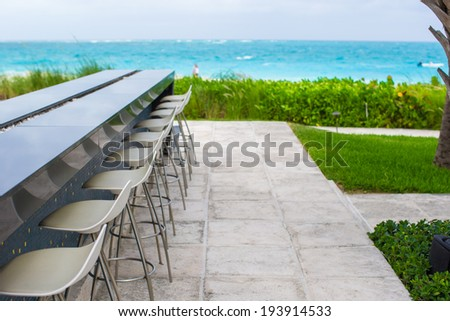 Outdoor bar on tropical beach at Caribbean background the sea - stock photo