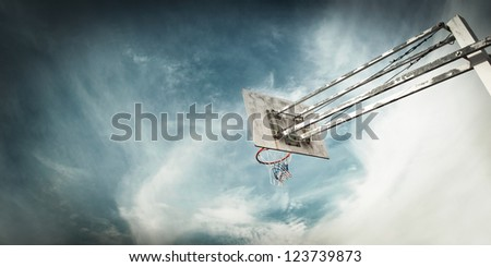 Outdoor Basketball basket against a blue sky - stock photo