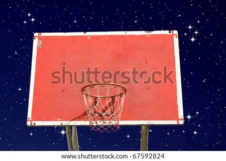 Outdoor basketball hoop on night sky - stock photo