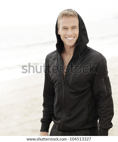 Outdoor bright portrait of a smiling young man - stock photo