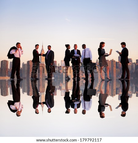 Outdoor Business Meeting at Dusk with New York Skyline - stock photo