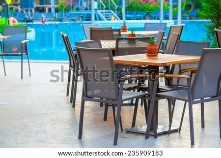 outdoor cafes near the swimming pool at dawn - stock photo