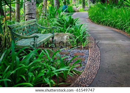 Outdoor chair and walkway in the garden - stock photo