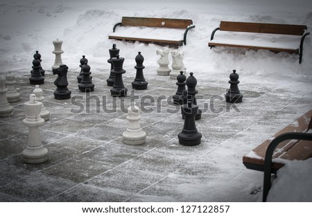 Outdoor chess in winter - stock photo