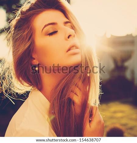 Outdoor closeup colorful toning sensual summer portrait of young beautiful woman.  - stock photo