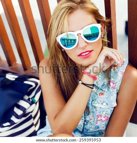 Outdoor closeup portrait of young pretty sensual blonde woman in sunglasses having fun outdoor in summer on the street colorful portrait in sunglasses  - stock photo