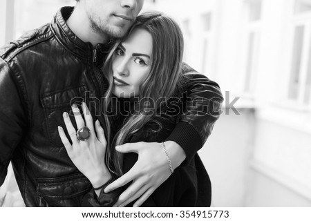 Outdoor closeup portrait of young sensual couple in love posing on the street in spring  - stock photo