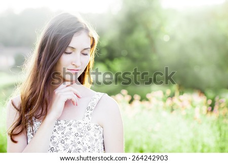 Outdoor color closeup fashion sensual portrait of young beautiful woman - stock photo