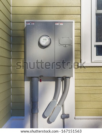 outdoor electrical panel on new house - stock photo