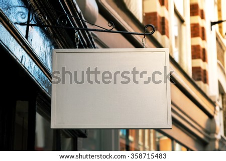 Outdoor empty white restaurants hanging sign  - stock photo