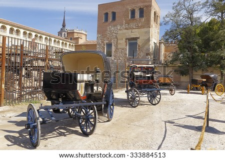 outdoor exposition of antique horse carriages on a medieval market at Alcala de Henares, Spain - stock photo